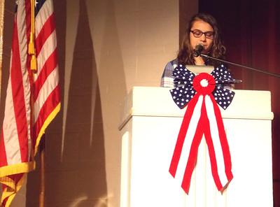 "Patriot photo by Lisa Mitchell Brandywine Heights School District's Veteran's Day program honors veterans. Brandywine 8th grader Alayna Biltcliff reads her poem ""The Flag."""