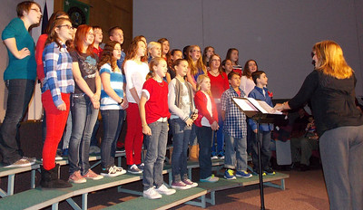 """Patriot photo by Lisa Mitchell Brandywine Heights Middle School Select Chorus sings """"Armed Forces - The Pride of America"""" recognizing veterans and Brandywine graduates currently serving during the Veteran's Day program Nov. 11."""