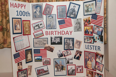 Patriot photos by Roxanne Richardson Lester Hoch (center), a native of Fleetwood, celebrated his 100th birthday with more than 100 friends and family at Fleetwood Grange on Sunday, Dec. 29.