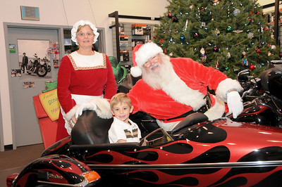 """Landyn Sterner (age 5) with Santa and Mrs. Clasus at Schaeffer's Harley-Davidson's annual """"Pictures with Santa"""" event.  Orwigsburg, PA"""