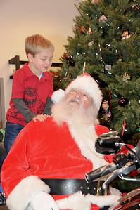Four year-old Robert Zawacki wants to make sure Santa hears that he'd been a good boy this year. Ashland, PA