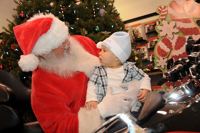 """8 month-old Anthony Gonzalez was sporting his brand new """"Baby's First Christmas"""" hat for his visit with Santa.  Pottsville, PA"""
