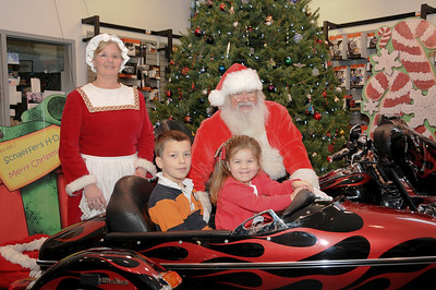 Wyatt (9) and his sister Riley (4) Strausser with Santa and Mrs. Claus. Mohnton, PA