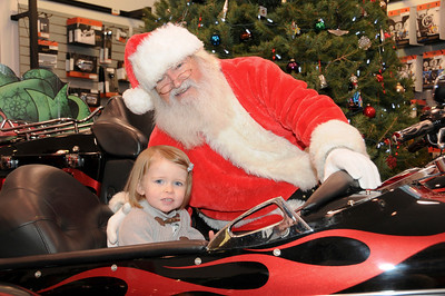 Two year-old Harper Yondura poses with Santa Claus. Port Carbon, PA