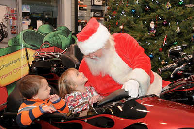 Five year-old Cameron Darosh waits patients while his little sister Kyla (age 3) tells Santa what she'd like for Christmas.  Auburn, PA