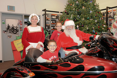 Juliessa (age 9) and her brother Noah Sonon (age 5) look forward to their annual photo with Santa at Schaeffer's Harley-Davidson.  Auburn, PA