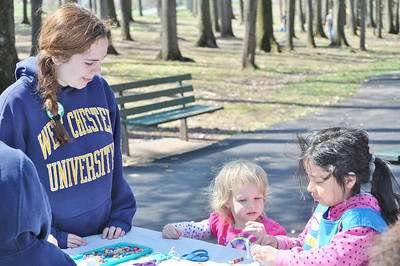 Submitted photo Ambassador Girl Scout, Emily Saxman assisting children in the making of bead jewelry.