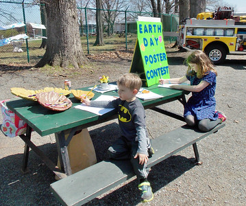 Jackson and Carlone Pengelly, ages 3 and 6, participate in the Earth Day coloring contest for children of all ages.