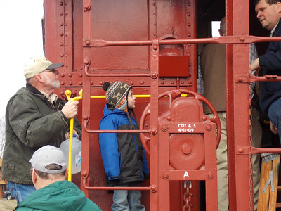 Richard Tobin aboards the caboose with his grandson Owen Richards.