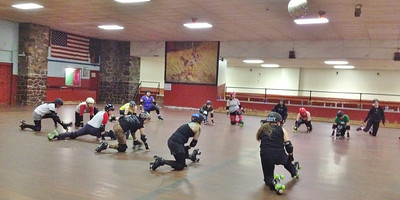 Skaters warm up at Fresh Meat practice on Sunday, March 9, at Ringing Rocks Roller Rink.