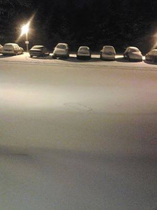 By Shannon Lambert-Foreman Snow turning into ice. Hilltop Court in Hamburg. That's my son's sled that is buried and now looks like a cookie cutter. Taken on 12/14/13.