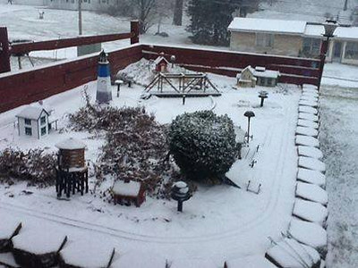 By Susan Boldt Looking out the back patio and the train yard is starting to get covered with snow! Taken on 1/2/14.